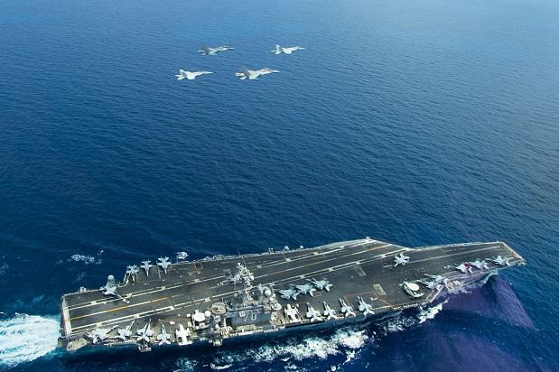 向中国正在南海修建新岛屿的区域不断派出美国侦查机